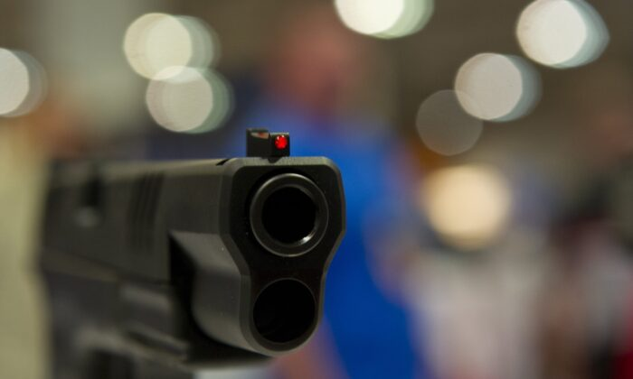 A semi-automatic handgun is displayed in a file photograph. (Karen Bleier/AFP via Getty Images)