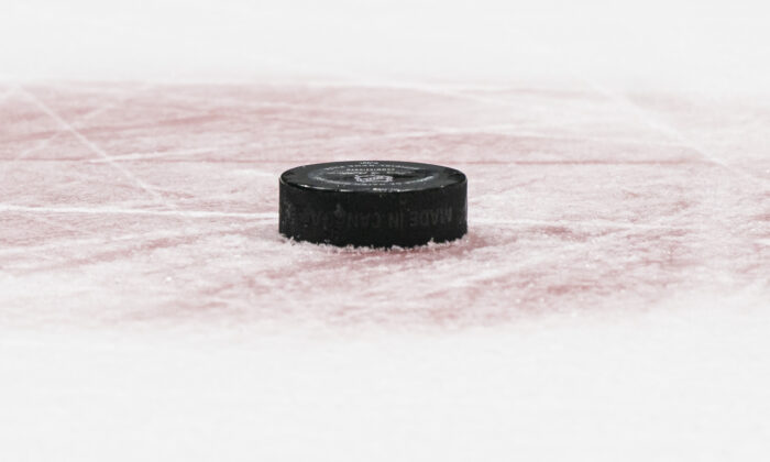 A hockey puck on the ice in a file photo. (Rich Lam/Getty Images)