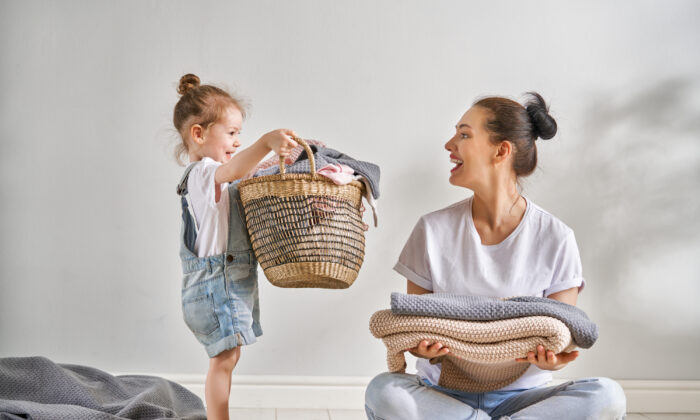 Taking the time to train children to do their chores has long-lasting benefits. (Yuganov Konstantin/Shutterstock)