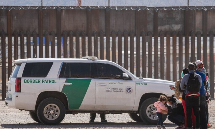 Border Patrol agents apprehend a group of illegal immigrants following the congressional border delegation visit near downtown El Paso, Texas, on March 15, 2021. (Justin Hamel/AFP via Getty Images)