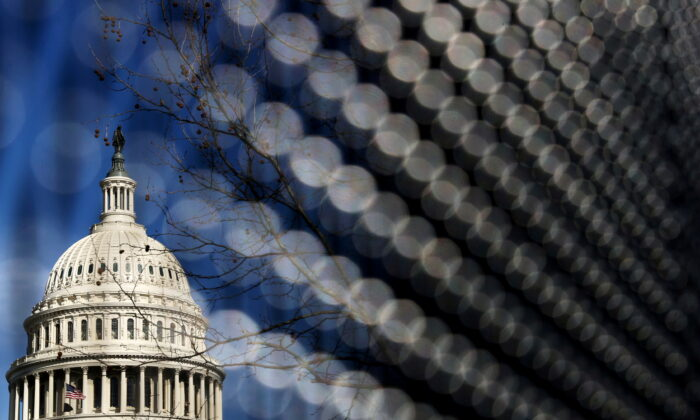 Light catches the security fence around the U.S. Capitol, erected in the wake of the January 6th attack but now scheduled to start being removed, in Washington on March 15, 2021. (Jonathan Ernst/Reuters)
