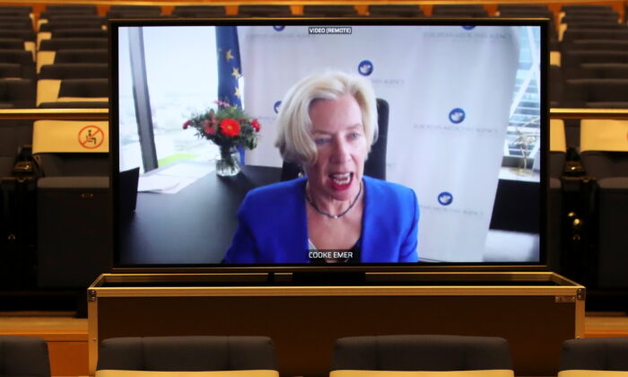 European Medicines Agency Executive Director Emer Cooke appears on screen during a video conference in Brussels on March 16, 2021. (Yves Herman/Pool/Reuters)