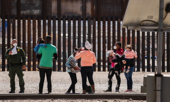 Border Patrol agents apprehend a group of illegal immigrants near downtown El Paso, Texas, on March 15, 2021. (Justin Hamel/AFP via Getty Images)