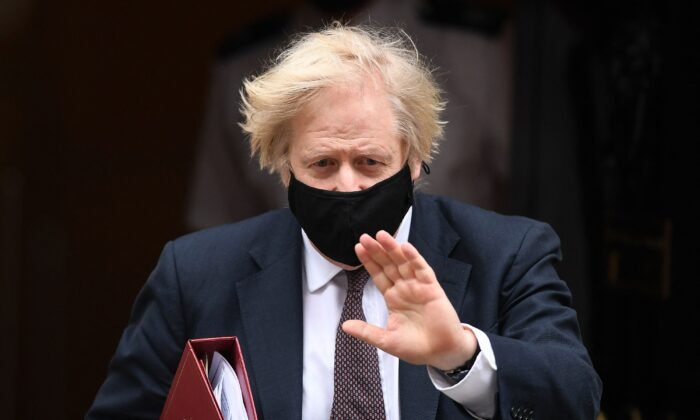 Britain's Prime Minister Boris Johnson, wearing a protective face covering, leaves 10 Downing Street in central London on March 17, 2021. (Daniel Leal-Olivas/AFP via Getty Images)
