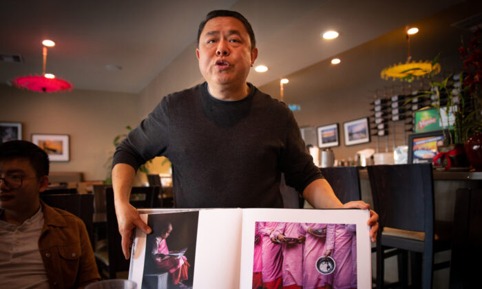 Restaurant owner Banny Hong holds a book showing pictures of Burma in Stanton, Calif., on March 8, 2020. (John Fredricks/The Epoch Times)
