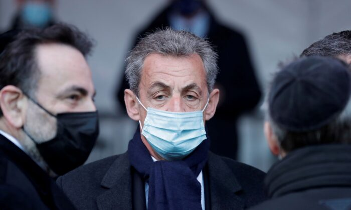 Former French president Nicolas Sarkozy waits before a ceremony paying homage to the victims of terrorism at the Invalides monument in Paris, France, on March 11, 2021. (Thibault Camus/Pool via Reuters)
