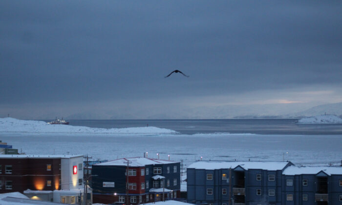 Downtown Iqaluit, Nunavut, is shown after 2 p.m. sunset on Nov. 24, 2020. (The Canadian Press/Emma Tranter)