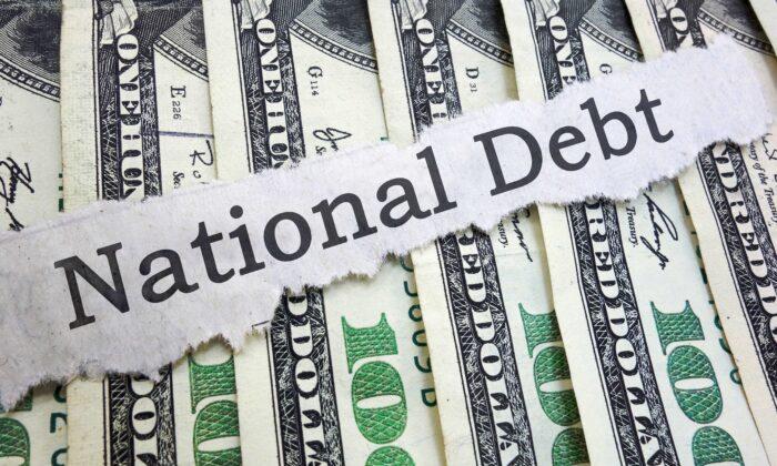 National Debt news headline on cash. (Tribune Content Agency)