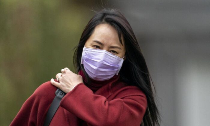Chief Financial Officer of Huawei Meng Wanzhou leaves her home in Vancouver, on March 18, 2021. (Jonathan Hayward/The Canadian Press)