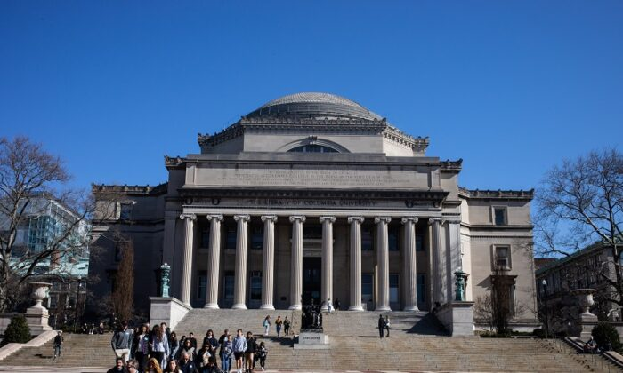 People walk on the Columbia University campus in New York City on March 9, 2020. (Jeenah Moon/Getty Images)
