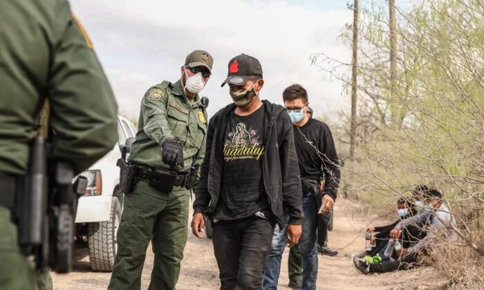 Border Patrol agents arrest seven illegal immigrants who tried to evade capture near Penitas, Texas, on March 15, 2021. (Charlotte Cuthbertson/The Epoch Times)