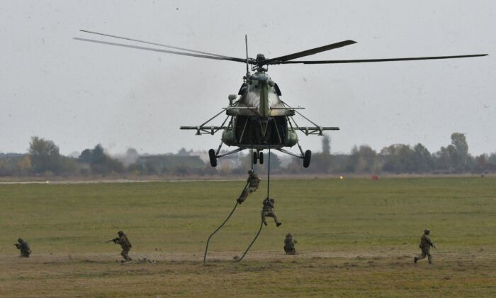Ukrainian troops land from Mi-8 helicopter, built with Motor Sich's engines, during an air force exercises in western Ukraine on Oct. 12, 2018. (Genya Savilov/AFP via Getty Images)