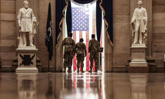 Members of the National Guard from Delaware tour the rotunda during their down time at the Capitol in Washington on Jan. 13, 2021. (Tasos Katopodis/Getty Images)