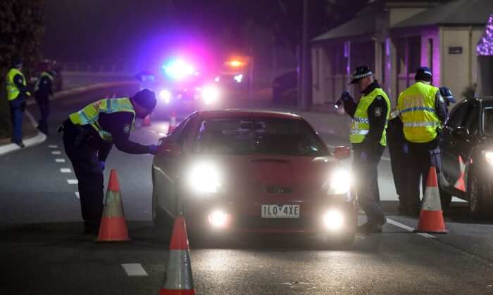 Police in the southern New South Wales (NSW) border city of Albury check cars crossing the state border from Victoria on July 7, 2020 as authorities close the border due to an outbreak of COVID-19 coronavirus in Victoria. (WILLIAM WEST/AFP via Getty Images)