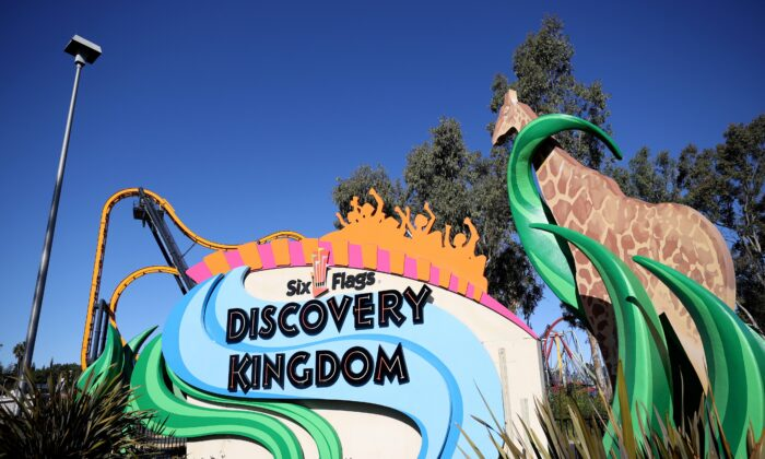 A sign is posted in front of the Six Flags Discovery Kingdom theme park in Vallejo, California, on Feb. 24, 2021. (Justin Sullivan/Getty Images)