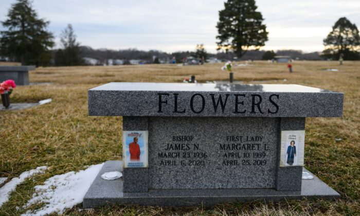 The grave of Bishop James N. Flowers, who passed away from COVID-19 in April 2020, is seen at a cemetery in Hyattsville, Maryland on Feb. 23, 2021. (Andrew Caballero-Reynolds/AFP via Getty Images)