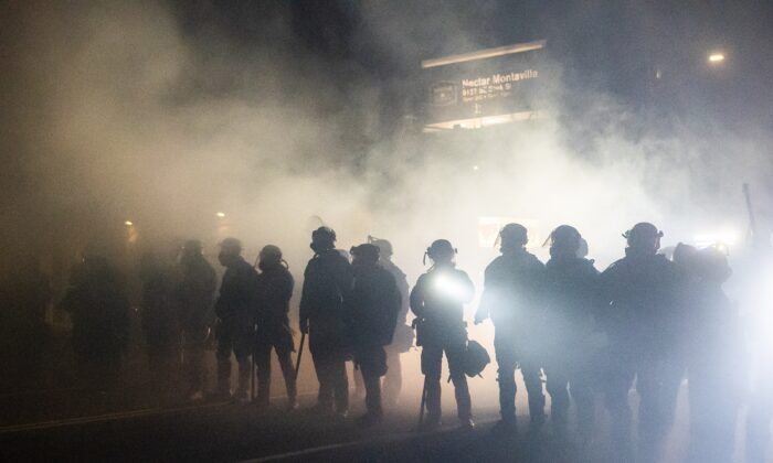Oregon state troopers and Portland police officers clash with demonstrators in Portland, Ore., on Sept. 5, 2020. (Nathan Howard/Getty Images)