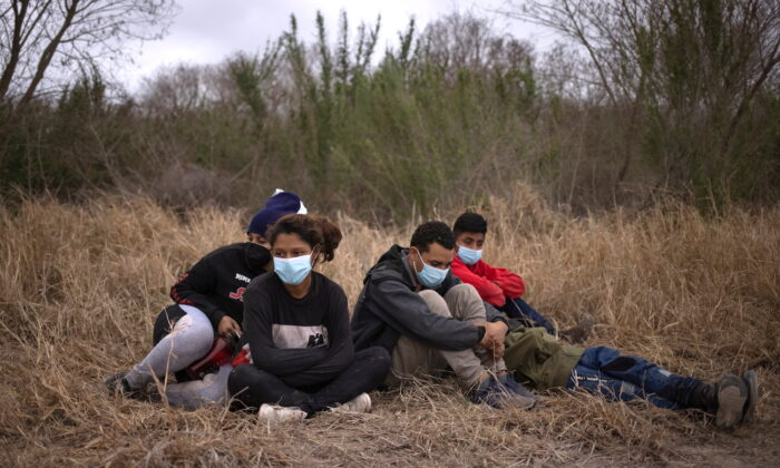 Unaccompanied minors from Central America are separated from other illegal immigrants by U.S. Border Patrol agents after crossing the Rio Grande river into the United States from Mexico on a raft in Penitas, Texas, on March 14, 2021. (Adrees Latif/Reuters)