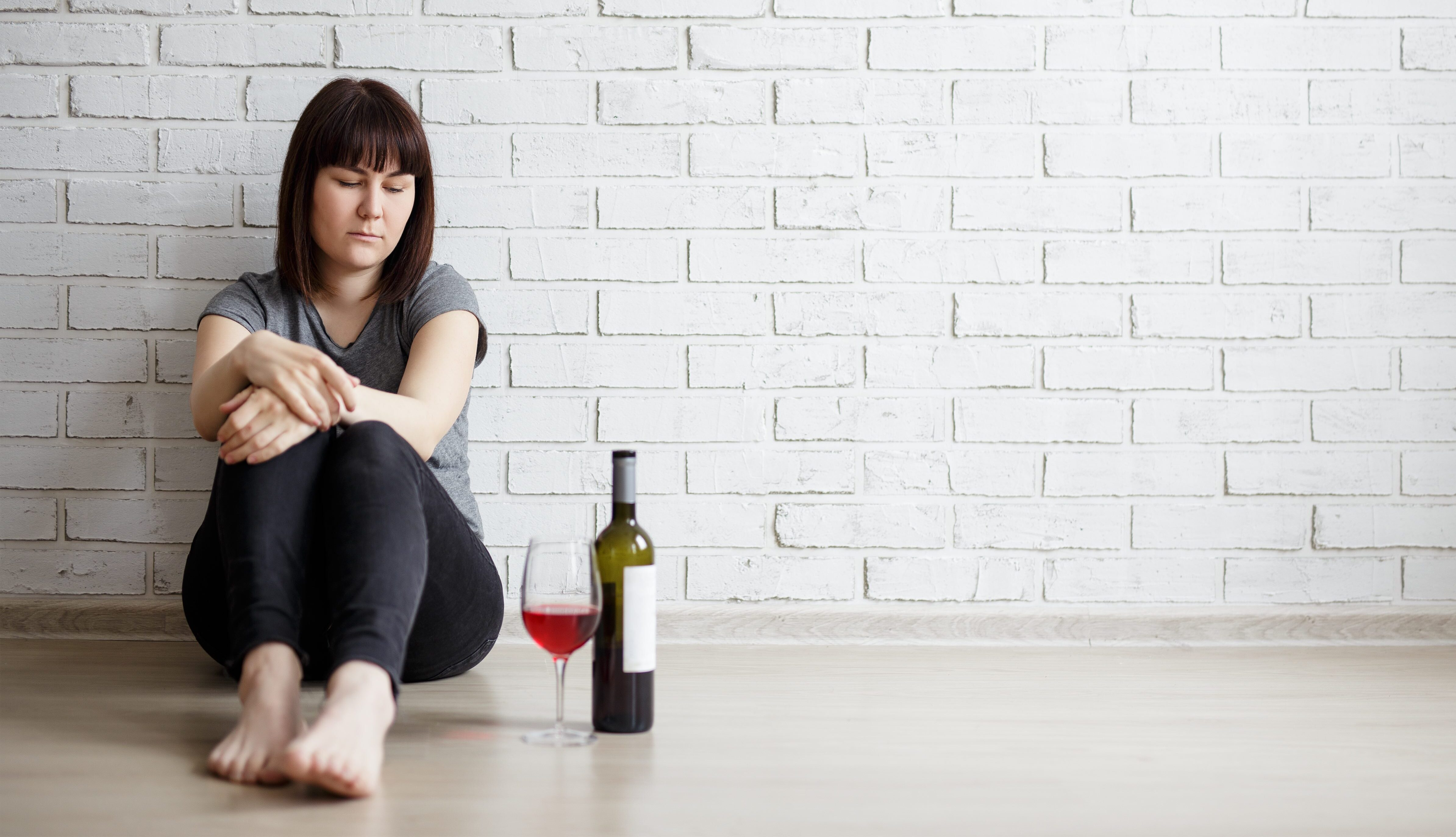 Alcohol can offer a numbing respite from grief but it doesn't truly help us recover from the loss of a loved one. (Di Studio/Shutterstock)