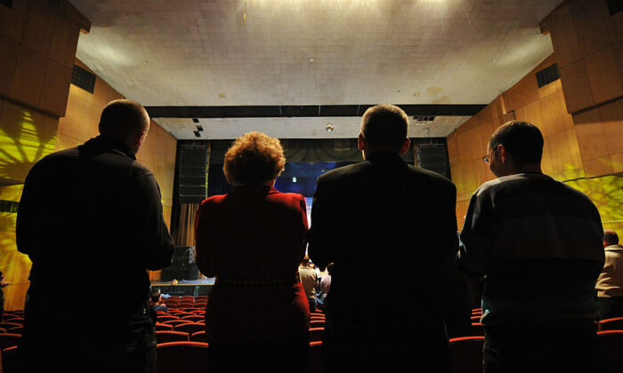 Members of Alcoholics Anonymous take part in a meeting in Moscow, on Dec. 1, 2012. (YURI KADOBNOV/AFP via Getty Images)