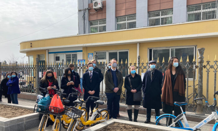 Foreign diplomats gather near a court building in Dandong in northeastern China's Liaoning Province, March 19, 2021. China was expected to open the first trial Friday for Michael Spavor, one of two Canadians who have been held for more than two years in apparent retaliation for Canada's arrest of a senior Chinese telecom executive. (Ken Moritsugu/AP Photo)
