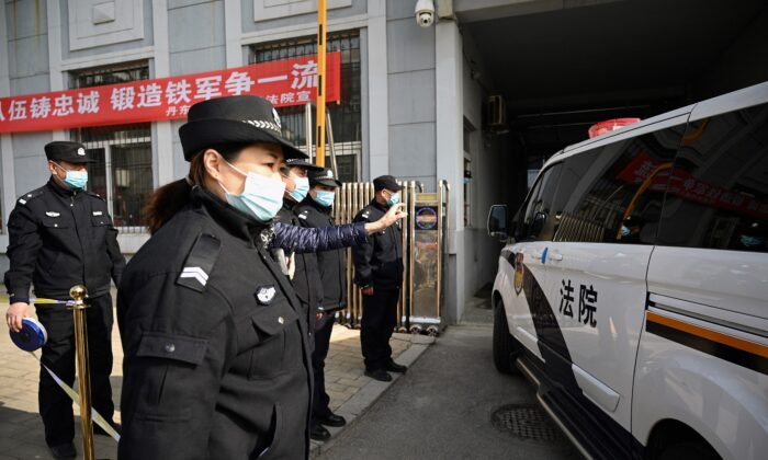 A police vehicle arrives at the side entrance of the Dandong Intermediate People's Court, where Canadian businessman Michael Spavor will be on trial, in the border city of Dandong in China's northeast Liaoning province on March 19, 2021. (Noel CelisS/AFP via Getty Images)