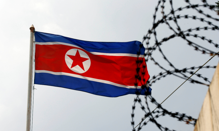 The North Korea flag flutters next to concertina wire at the North Korean embassy in Kuala Lumpur, Malaysia March 9, 2017. (Edgar Su/Reuters)