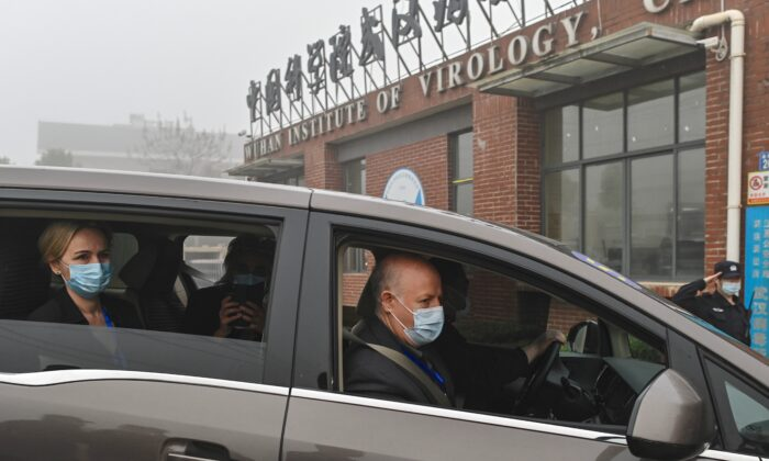 Peter Daszak (R) and other members of the World Health Organization (WHO) team investigating the origins of the COVID-19 coronavirus, arrive at the Wuhan Institute of Virology on Feb. 3, 2021. (Hector Retamal/AFP via Getty Images)