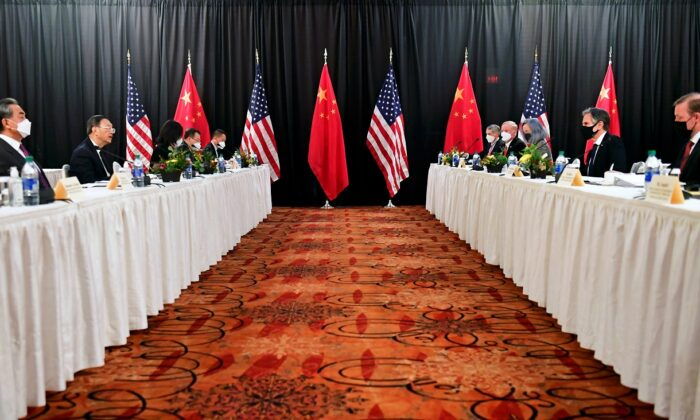 U.S. Secretary of State Antony Blinken (2nd R), joined by National Security Adviser Jake Sullivan (R), speaks while facing Yang Jiechi (2nd L), director of the Central Foreign Affairs Commission Office, and Wang Yi (L), China's State Councilor and Foreign Minister, at the opening session of U.S.–China talks at the Captain Cook Hotel in Anchorage, Alaska, on March 18, 2021. (Frederic J. Brown/Reuters)