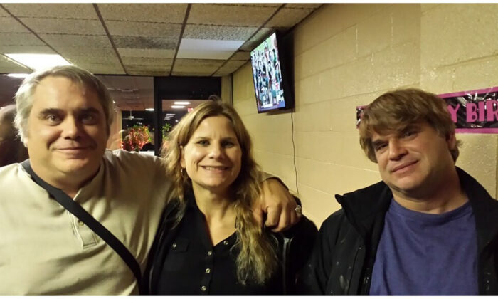 This photo provided by John Michels (L) shows his brother Paul Andre Michels (R) posing with his sister Sarah Michels and himself, in Allen Park, Mich., in October 2015. (John Michels via AP)
