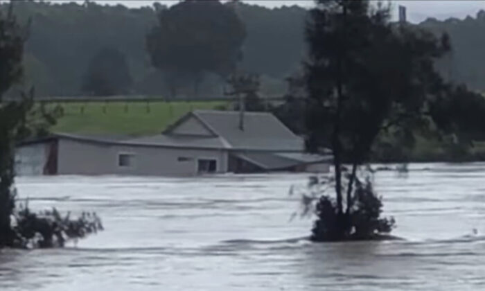 A screenshot of a supplied video shows a house floating down the Manning River in Taree, NSW, Saturday, March 20, 2021. (AAP Image/Supplied by Ciara Knox)
