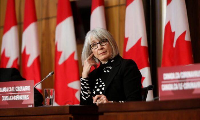 Health Minister Patty Hajdu listens at a COVID-19 press conference in Ottawa, Canada, on Dec. 11, 2020. (The Canadian Press/David Kawai)