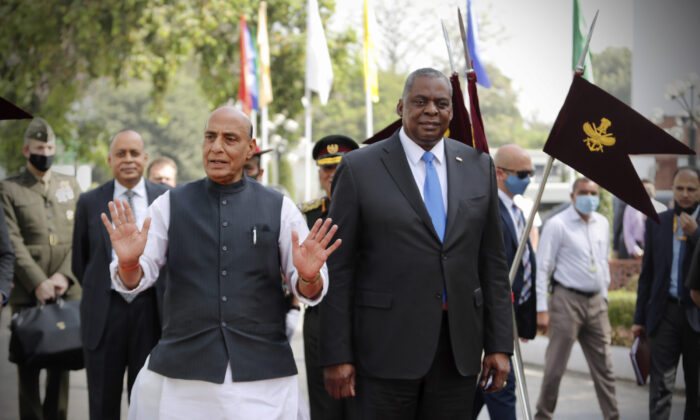 U.S. Defense Secretary Lloyd Austin (R) walks with Indian Defense Minister Rajnath Singh (L) in New Delhi, India, on March 20, 2021. (Manish Swarup/AP Photo)