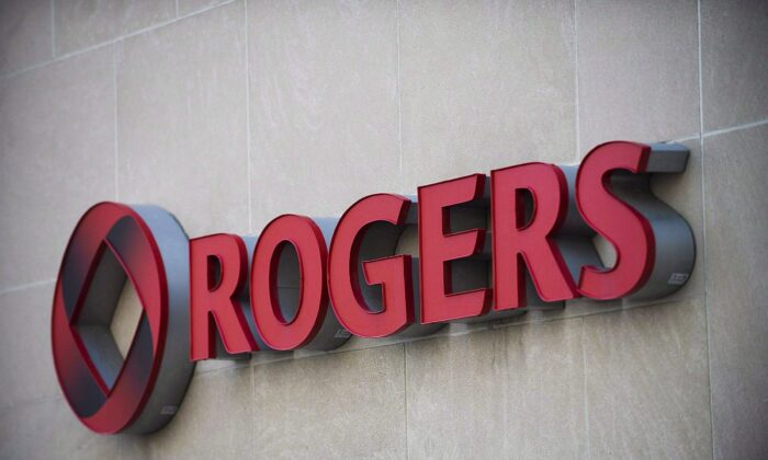 The Rogers sign at the company's headquarters in Toronto in a file photo. Rogers Communications Inc. has offered to buy Shaw Communications Inc. in a deal worth $26 billion. (The Canadian Press/Aaron Vincent Elkaim)