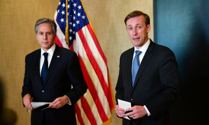 U.S. Secretary of State Antony Blinken (L) and national security adviser Jake Sullivan (R) address the media following the closed-door morning talks between the United States and China upon the conclusion of their two-day meetings in Anchorage, Alaska, on March 19, 2021. (Frederic J. Brown/POOL/AFP via Getty Images)