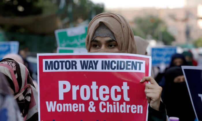 A supporter of religious and political party Jamaat-e-Islami (JI) carries a sign against agangrapethat occurred along a highway, and to condemn the violence against womenand girls, during a demonstration in Karachi,Pakistan, Sept. 11, 2020. (Akhtar Soomro/Reuters, File)