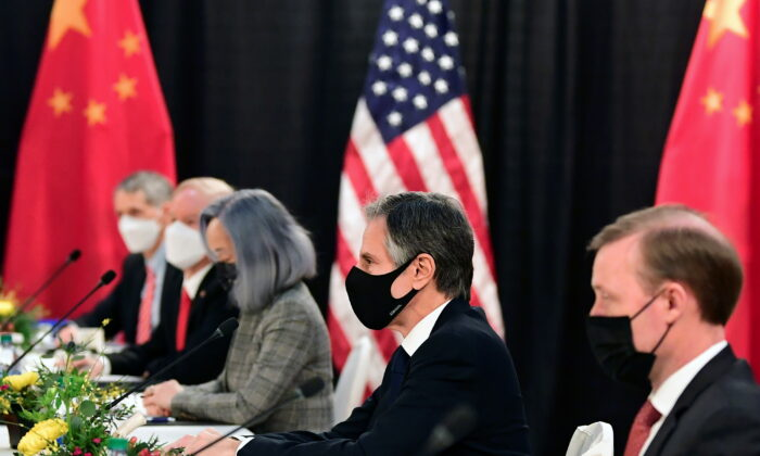 The U.S. delegation led by Secretary of State Antony Blinken (C) and flanked by National Security Advisor Jake Sullivan (R), face their Chinese counterparts at the opening session of U.S.-China talks at the Captain Cook Hotel in Anchorage, Alaska, on March 18, 2021.  (Frederic J. Brown/Pool via Reuters)