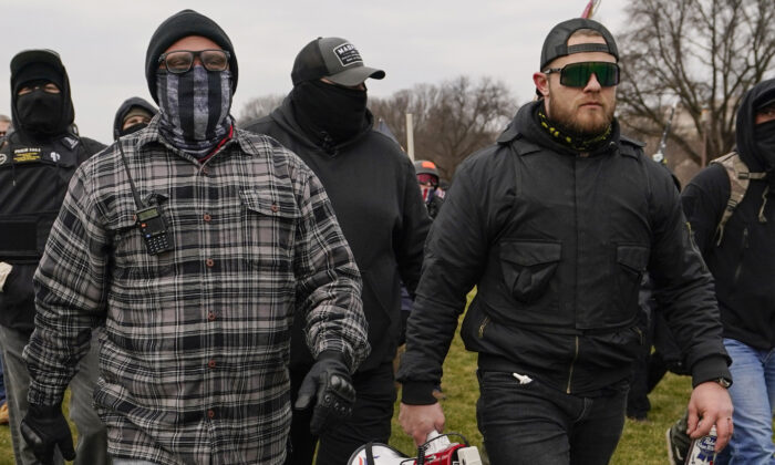Proud Boys members Joseph Biggs, left, and Ethan Nordean, right, with megaphone, walk toward the U.S. Capitol in Washington on Jan. 6, 2021. (Carolyn Kaster/AP Photo)