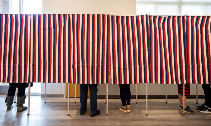 Voters fill in their ballots at polling booths in Concord, N.H., on Nov. 3, 2020. (Joseph Prezioso/AFP via Getty Images)