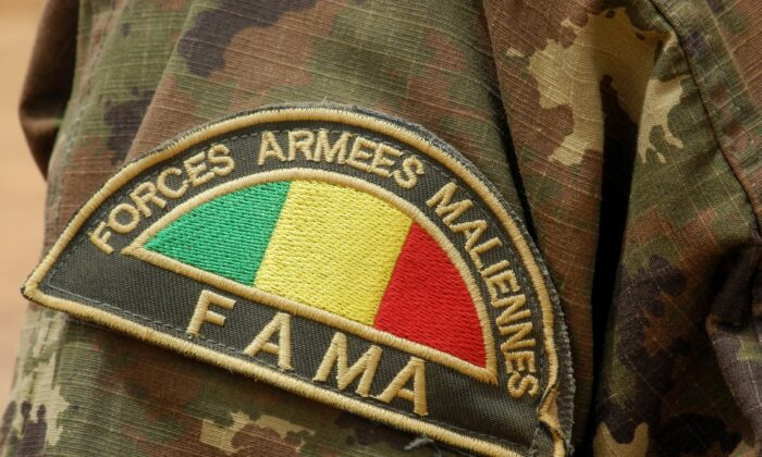 Detail of the badge of a member of the Malian Army (Fama), in Anderamboukane, in Menaka region, on March 22, 2019. (Agnes Coudurier/AFP via Getty Images)