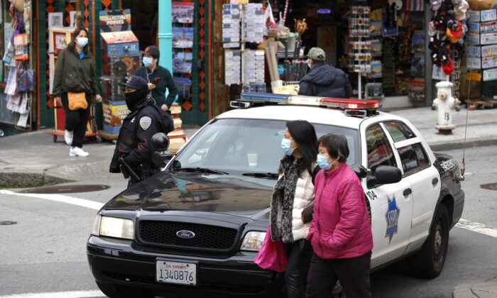 A police officer on Grant Avenue, Chinatown, in San Francisco on March 17, 2021. (Justin Sullivan/Getty Images)