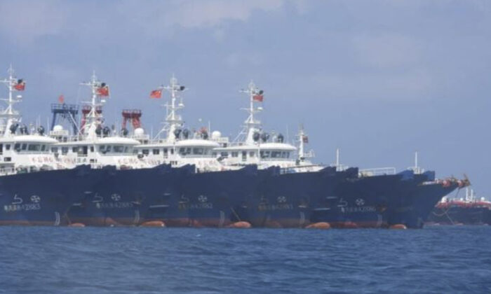 Some of the 220 Chinese vessels are seen moored at Whitsun Reef, South China Sea on March 7, 2021. (Philippine Coast Guard/National Task Force-West Philippine Sea via AP)