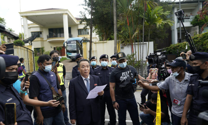 Kim Yu Song, center, a counselor at the North Korean Embassy to Malaysia, reads out a statement outside the embassy in Kuala Lumpur, Sunday, March 21, 2021. (Vincent Thian/AP)