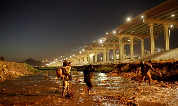 Illegal immigrants cross the Rio Bravo river in El Paso, Texas, on March 19, 2021. (Jose Luis Gonzalez/Reuters)