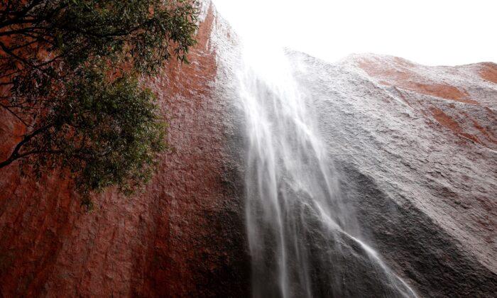 A waterfall is seen in Kantju Gorge as it rains at Uluru in Uluru-Kata Tjuta National Park, Australia, on Nov. 28, 2013. (Mark Kolbe/Getty Images)