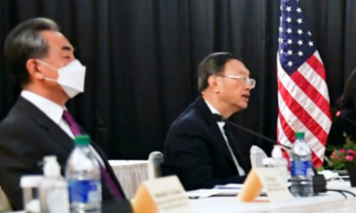 Yang Jiechi (R), director of the Central Foreign Affairs Commission Office, and Wang Yi (L), China's State Councilor and Foreign Minister, at the opening session of U.S.-China talks at the Captain Cook Hotel in Anchorage, Alaska, on March 18, 2021. (Frederic J. Brown/Pool via Reuters)