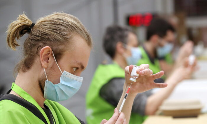 Medical workers prepare doses of Oxford/AstraZeneca's COVID-19 vaccine at a vaccination centre in Antwerp, Belgium, on March 18, 2021. (Yves Herman/Reuters)