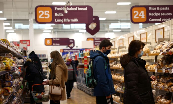 Shoppers look at bread in a Sainsbury's supermarket, amid the CCP virus outbreak, in London on Jan. 12, 2021. (Henry Nicholls/Reuters)