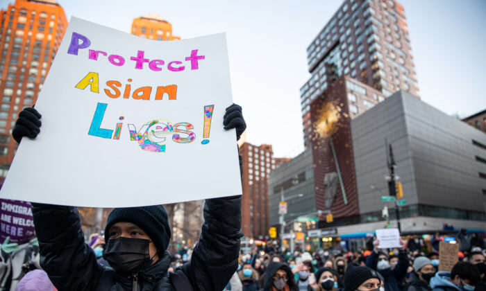 People attend the Peace Vigil for Victims of Asian Hate at Union Square Park in New York on March 19, 2021. (Chung I Ho/The Epoch Times)