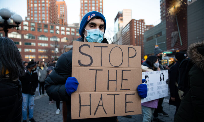 People attend a vigil for victims of anti-Asian hate crimes at Union Square in New York on March 19, 2021. (Chung I Ho/The Epoch Times)